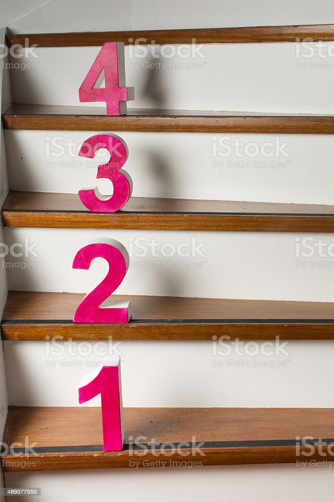 4 steps up the stairs stock photo