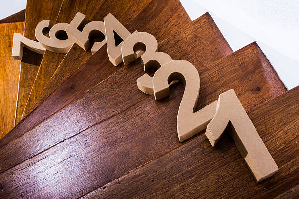 7 steps up the stairs cardboard numbers on a wooden straircase number 7 stock pictures, royalty-free photos & images