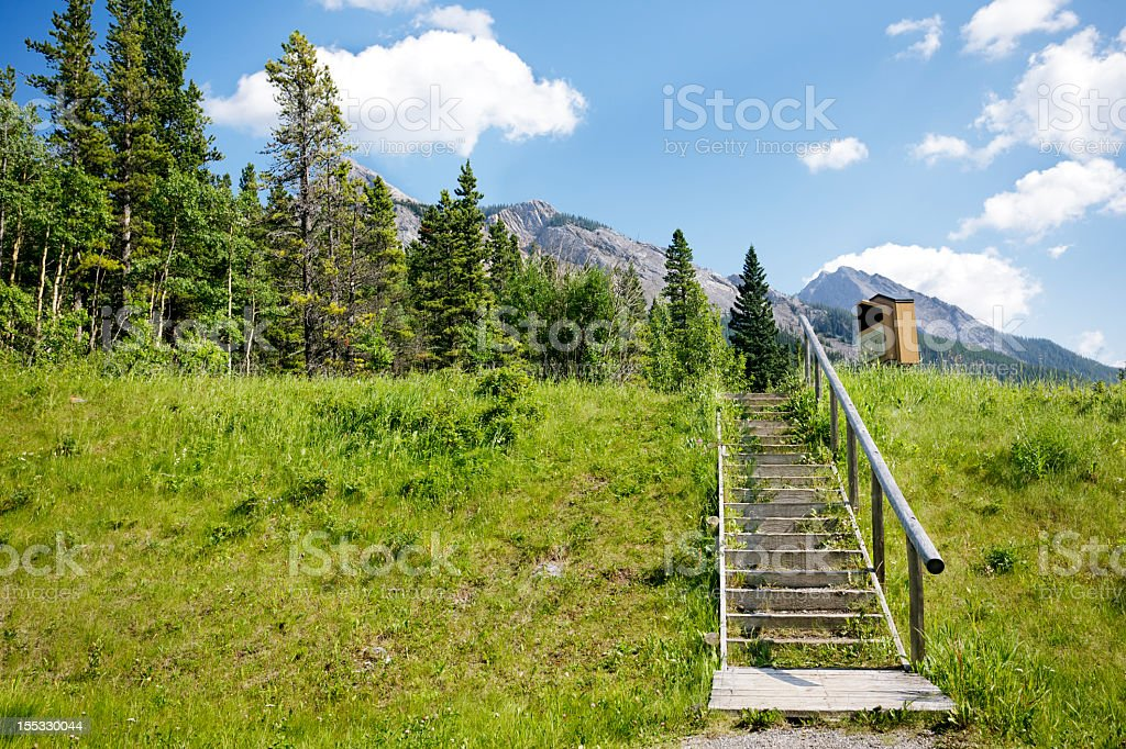 Steps up to a mountain  trail head stock photo