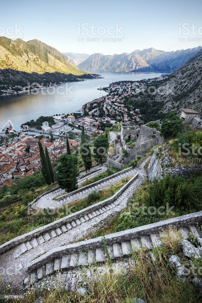 Steps Winding past Historic Ruins Overlooking Kotor Bay and City stock photo
