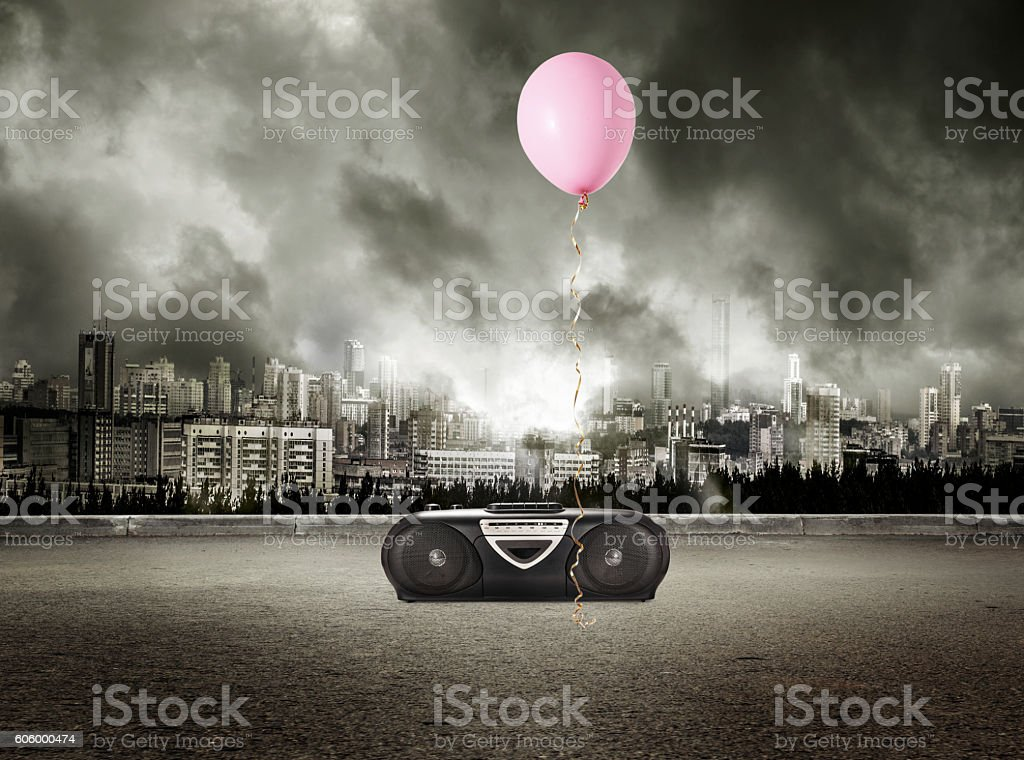 Stereo tape recorder and red balloon on storm stock photo