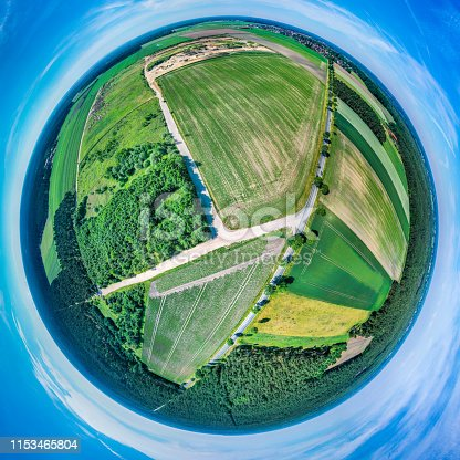 istock Stereoscopic spherical panorama of a flat landscape in Northern Germany with fields, meadows and forests, aerial photograph, drone shot 1153465804