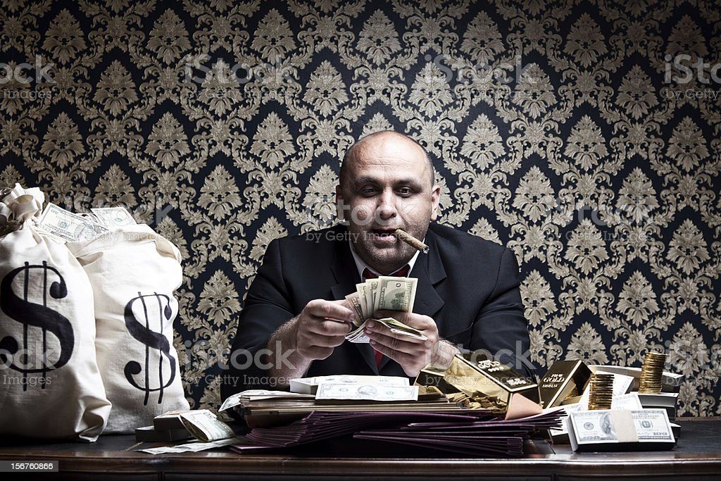 Stereotype Rich Man Posing With Money Bags,Counting Dollar Bills stock photo