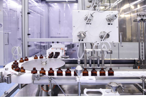 Sterile capsules for injection. Bottles on the bottling line of the pharmaceutical plant. Machine after checking sterile liquids. Interferon, nasoferon. stock photo