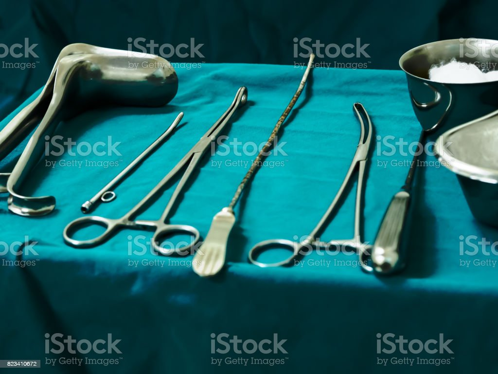 Sterile curettage tools, forceps, retractor in operation room at medical hospital for treatment of abortion, abnormal female menstruation period or bleeding, miss carriage Sterile curettage tools, forceps, retractor in operation room at medical hospital for treatment of abortion, abnormal female menstruation period or bleeding, miss carriage Gynecological Examination Stock Photo