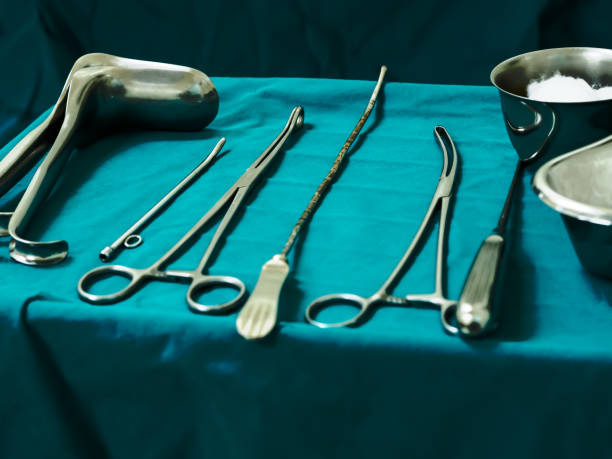 Sterile curettage tools, forceps, retractor in operation room at medical hospital for treatment of abortion, abnormal female menstruation period or bleeding, miss carriage stock photo