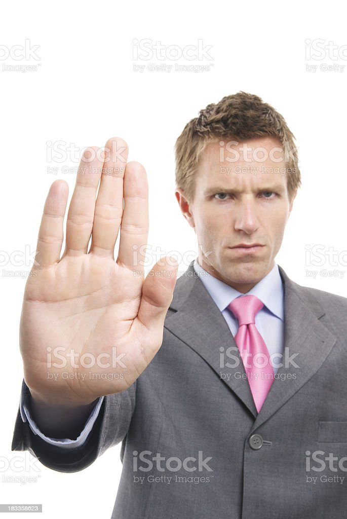 Stern Businessman Holds Up His Palm Stop royalty-free stock photo