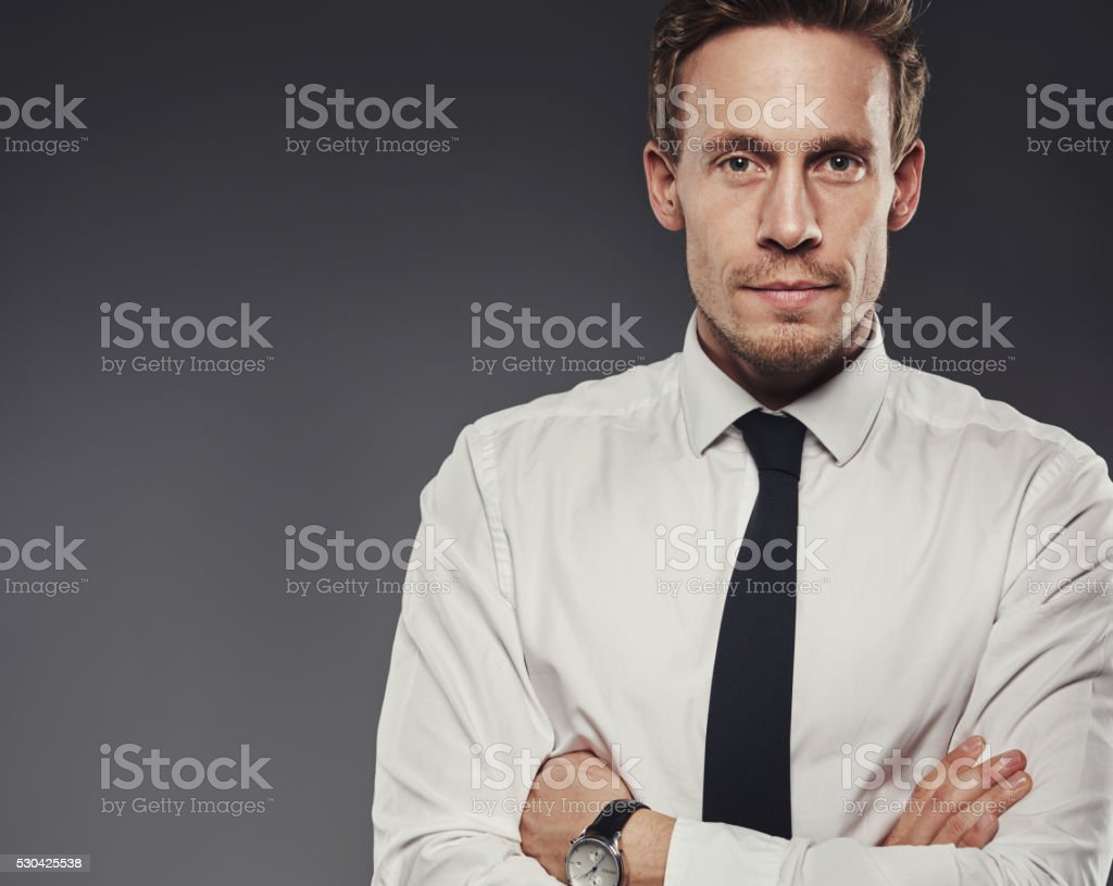 Stern grim businessman with folded arms stock photo