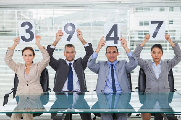 stern interview panel holding signs giving mark - scoring stock photos and pictures
