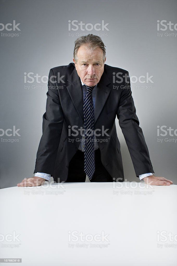 Stern Looking Bank Manager Portrait royalty-free stock photo
