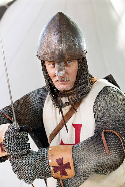 stern looking knight in a fighting pose - the crusades stock photos and pictures
