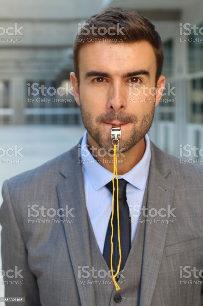 Stern man blowing the whistle in office space royalty-free stock photo
