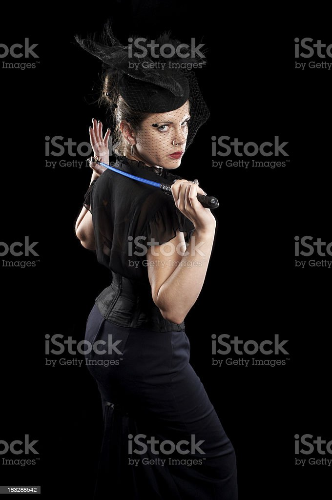 Stern mistress with riding crop. stock photo