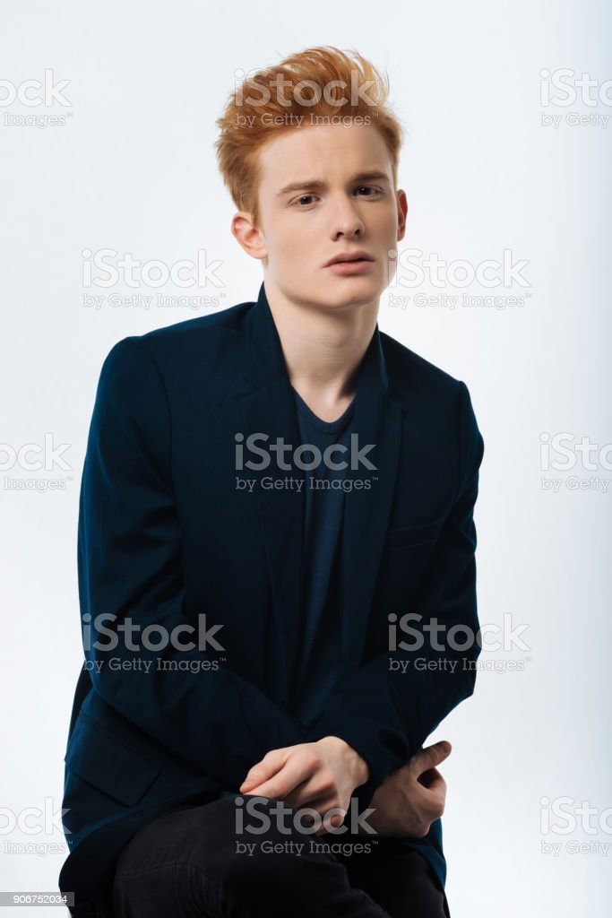 Stern red-haired man wearing a jacket stock photo