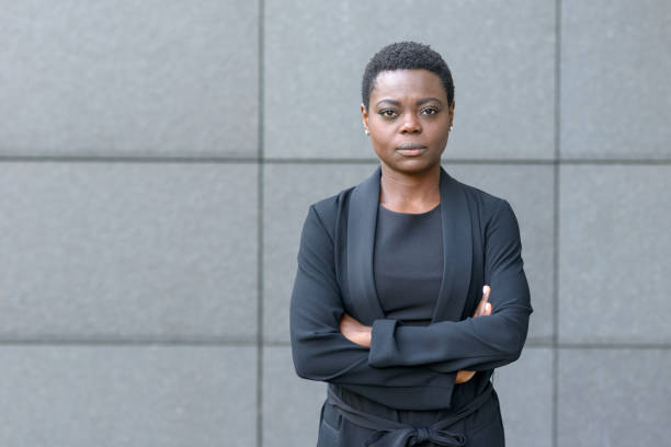 Stern serious young black businesswoman stock photo