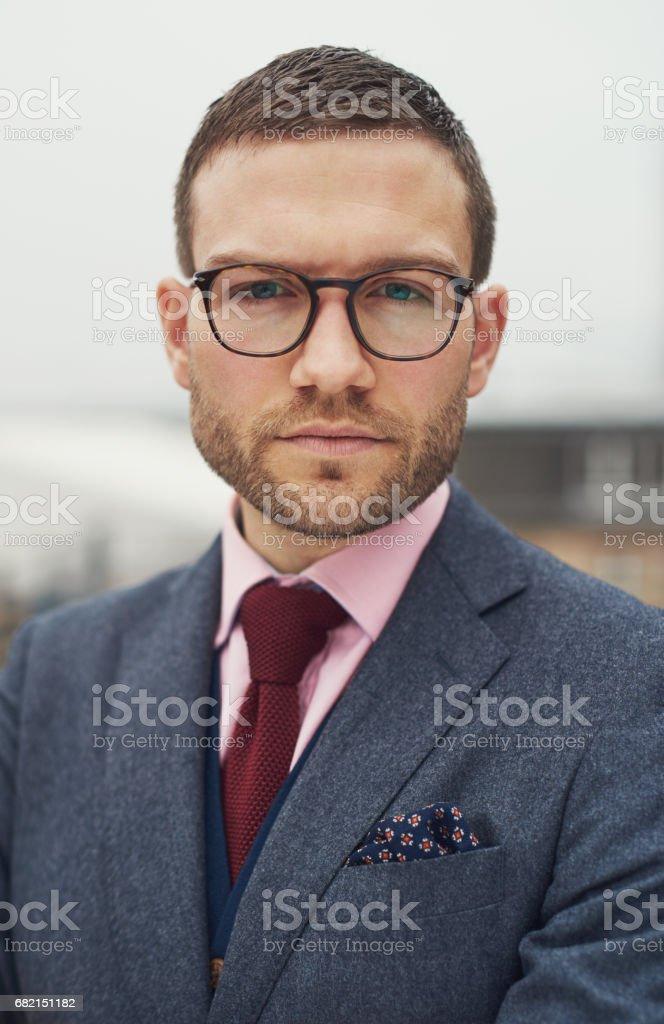 Stern stylish young businessman stock photo