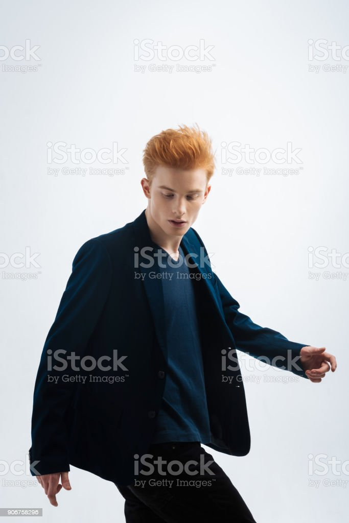 Stern young man looking down stock photo