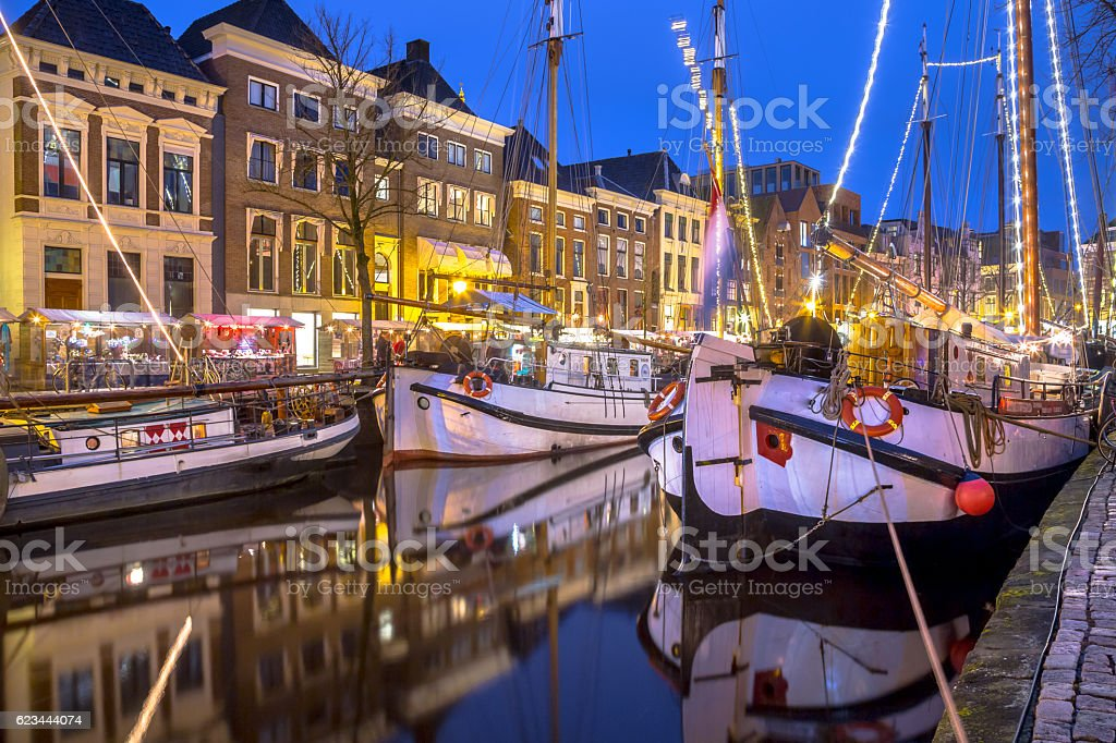 Sterns of historic sailing ships at the Hoge der Aa stock photo