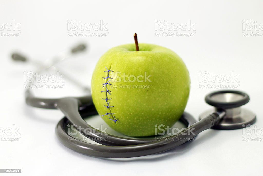 Stethoscope and apple royalty-free stock photo
