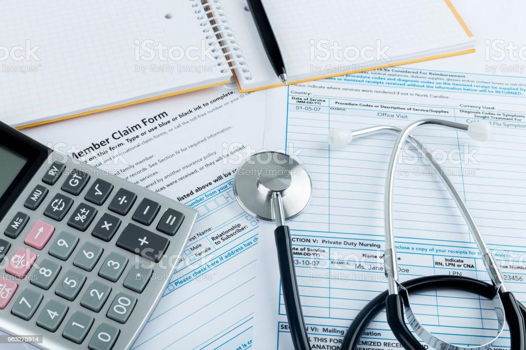 Stethoscope and calculator for health medical insurance