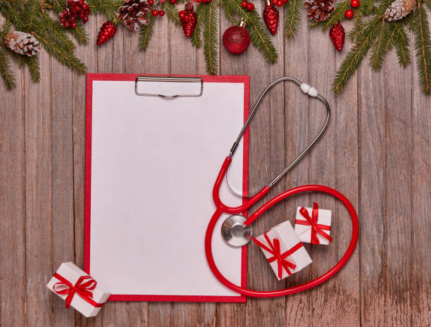 Stethoscope and Christmas decorations. stock photo