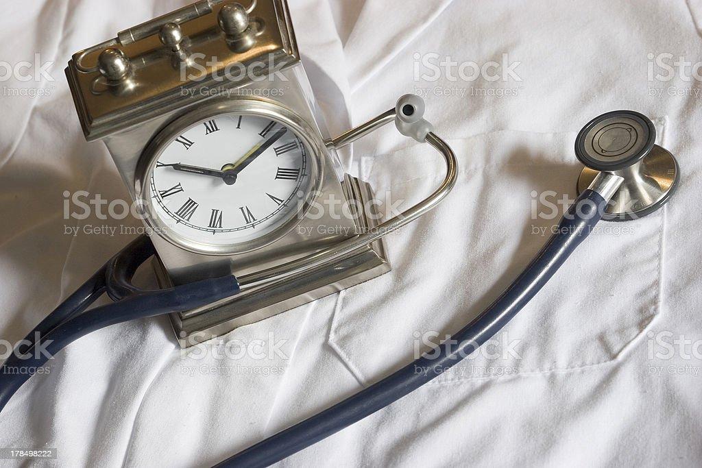 Stethoscope and Clock stock photo