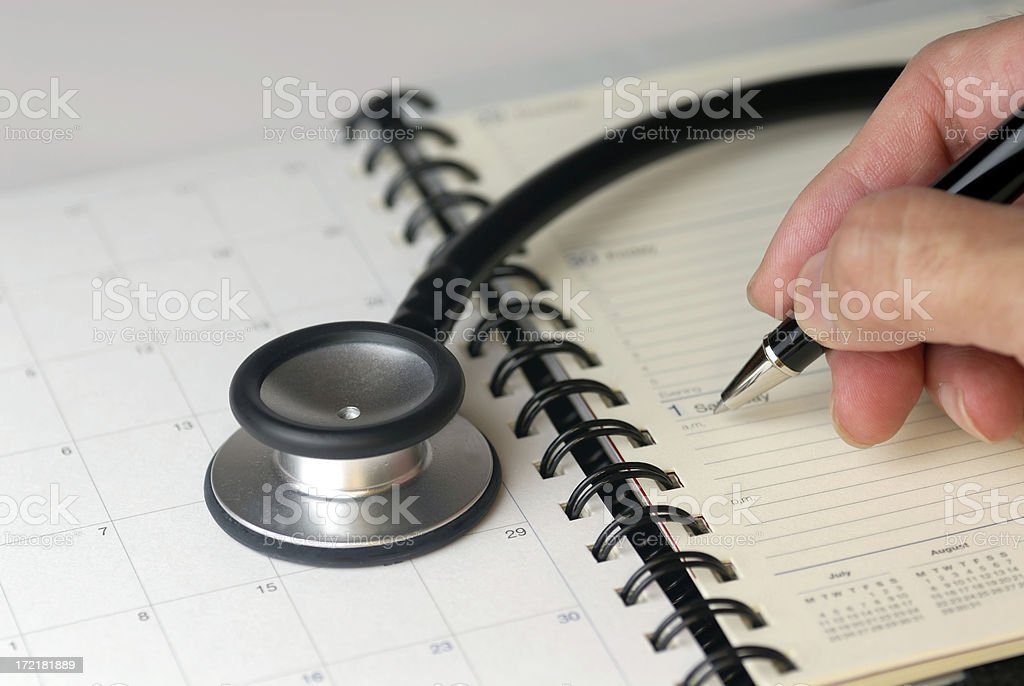 Stethoscope and diary for next appointment royalty-free stock photo