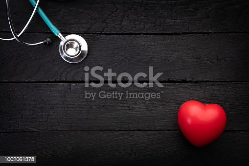 istock Stethoscope and heart background from above 1002061378