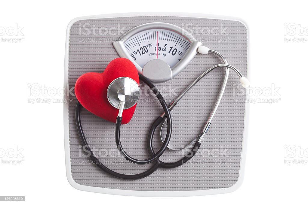 Stethoscope and heart on Bathroom Sacles royalty-free stock photo