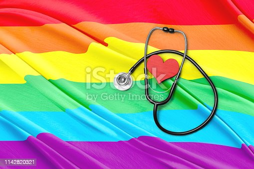 Stethoscope and heart shape with rainbow flag background. LGBT concept