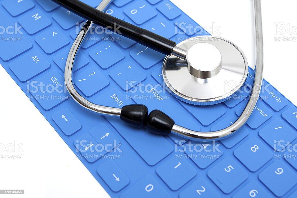 Stethoscope and Keyboard isolated on white background royalty-free stock photo