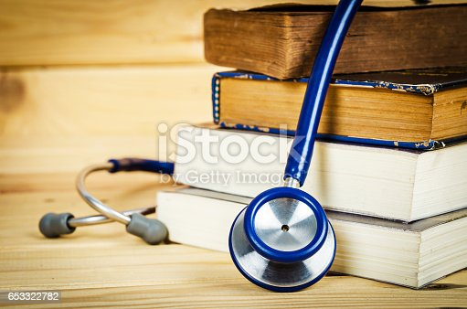 istock Stethoscope and old books. 653322782