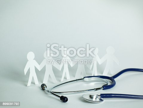 istock stethoscope and paper men on the table 899091792