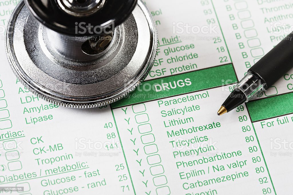 Stethoscope and pen on form recording drugs prescribed or taken stock photo