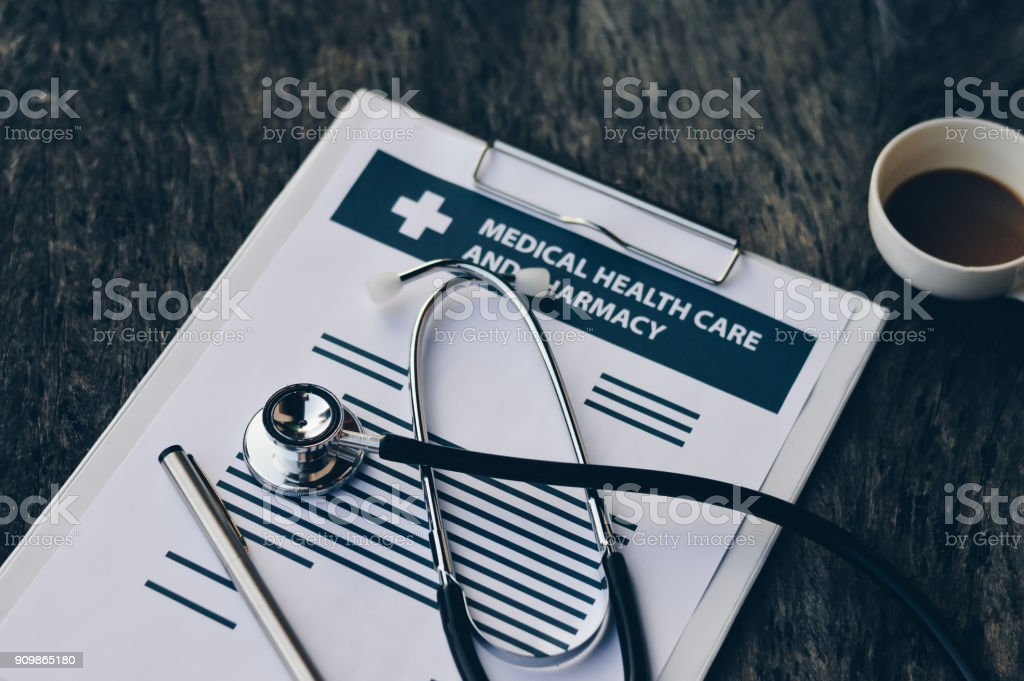 Stethoscope and pen on report pad ,health and medical concept...