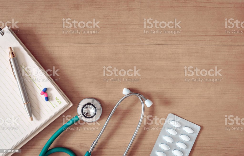 Stethoscope And Pill Of Health Checkup Insurance Statement