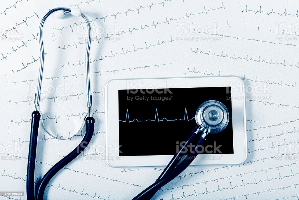 Stethoscope and Pulse Trace on Digital Tablet royalty-free stock photo