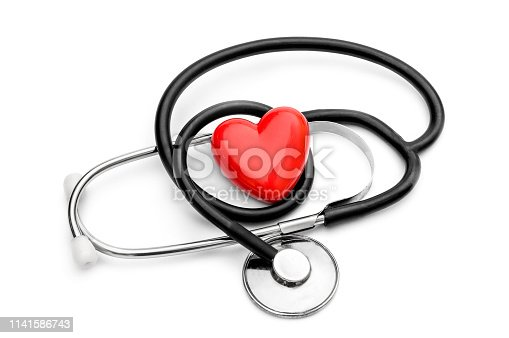 Stethoscope and red heart on white. Medical concept.