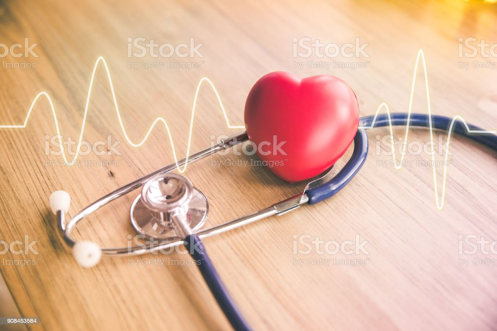 stethoscope and red heart with cardiogram stock photo
