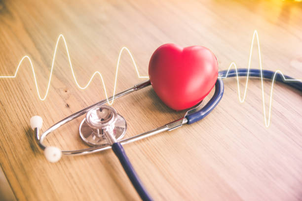 stethoscope and red heart with cardiogram - heart shape stock photos and pictures