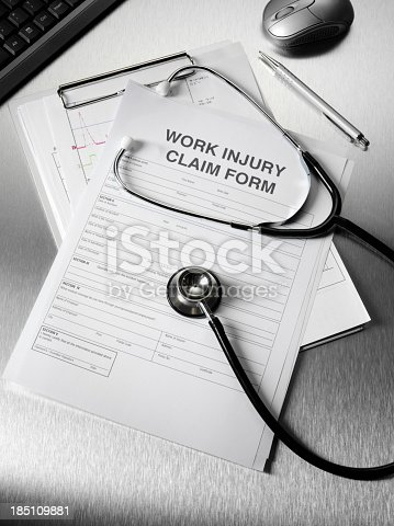 istock Stethoscope and Work Claim Form 185109881