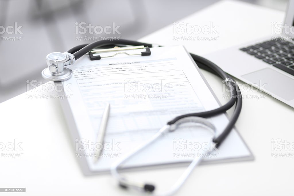 Stethoscope Clipboard With Medical Form Lying On Hospital