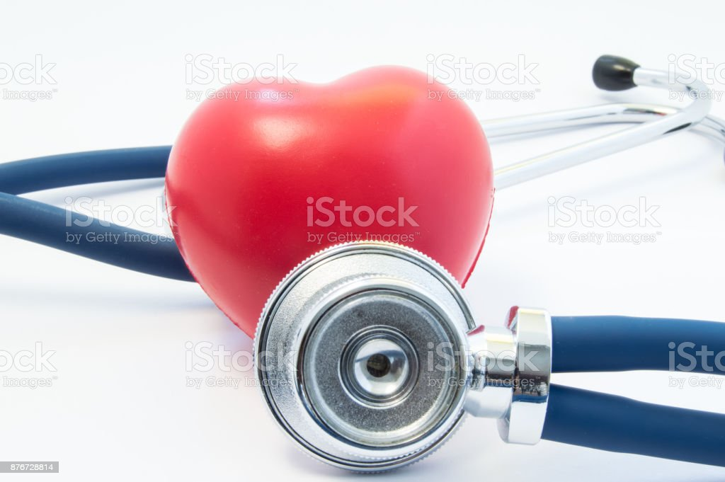 Stethoscope examines heart shape in front and twists around. Concept picture for process diagnostics, treatment and prevention of heart disease such as myocardial infarction, arrhythmia, heart failure stock photo