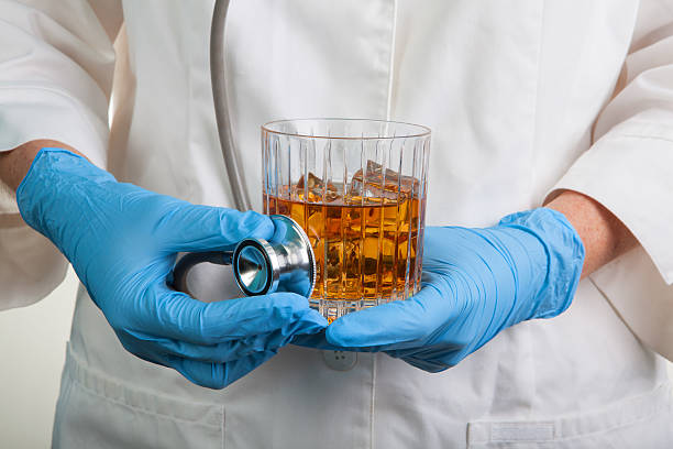 Stethoscope Food Health & Safety Glass of Wiskey hard alcohol stock photo