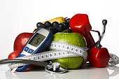 istock Stethoscope glucometer fruits and dumbbells, Diabetes concept 931519876