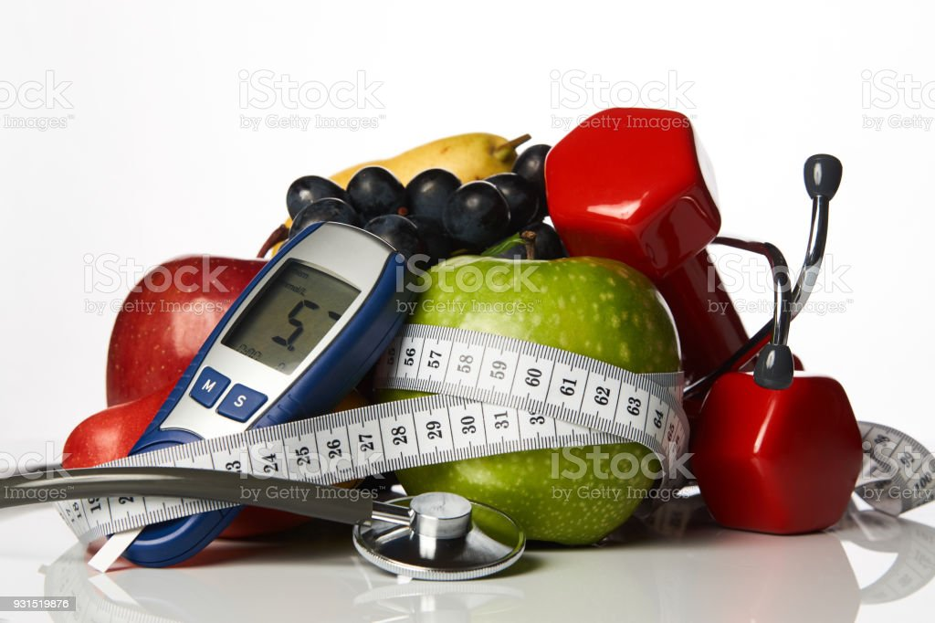 Stethoscope glucometer fruits and dumbbells, Diabetes concept stock photo