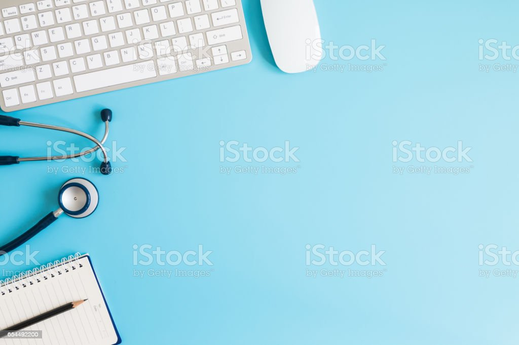 Stethoscope in doctors desk stock photo