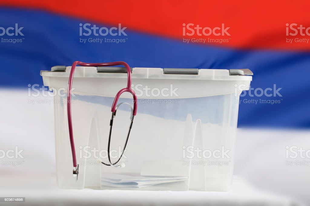 Stethoscope is hanging on the ballot box. stock photo