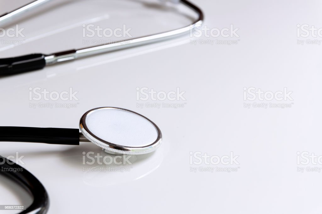 Stethoscope isolated on white table background. The stethoscope is a medical instrument for listening to the action of someone's heart or breathing. with copy space for your text. stock photo