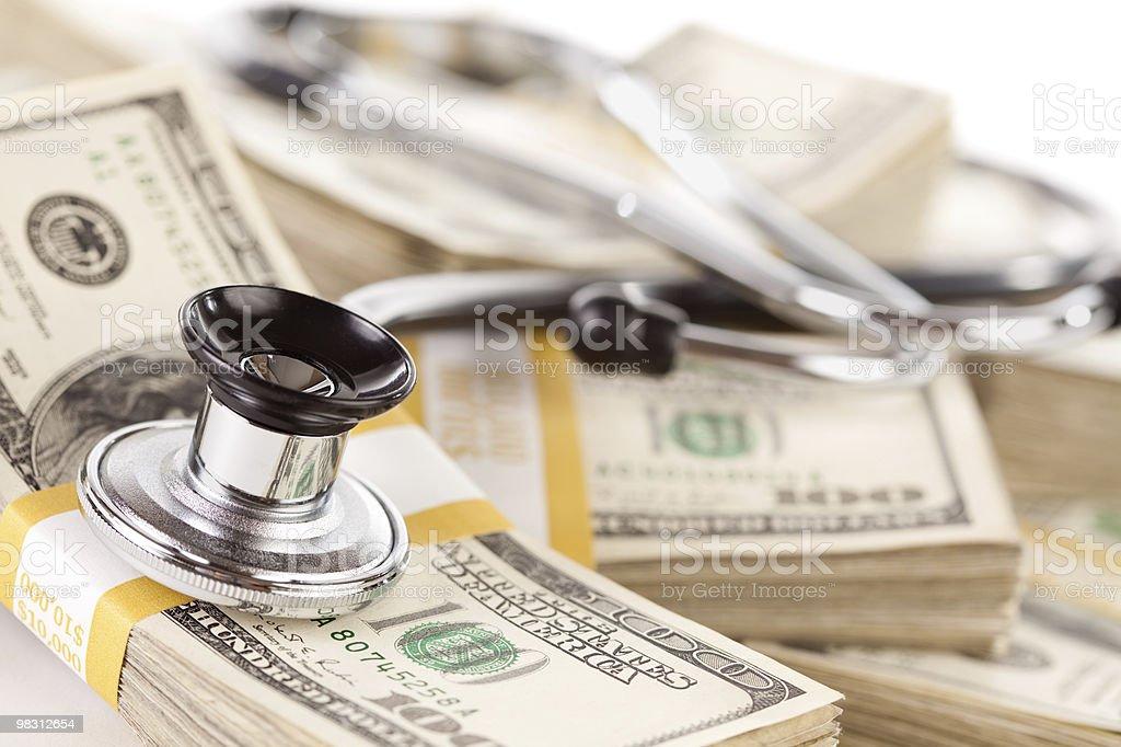 Stethoscope Laying on Stacks of Money royalty-free stock photo